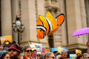 Picture of people at a rally with nemo floating above the crowd