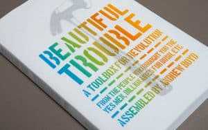 Photo of the front cover of the Beautiful Trouble book.
