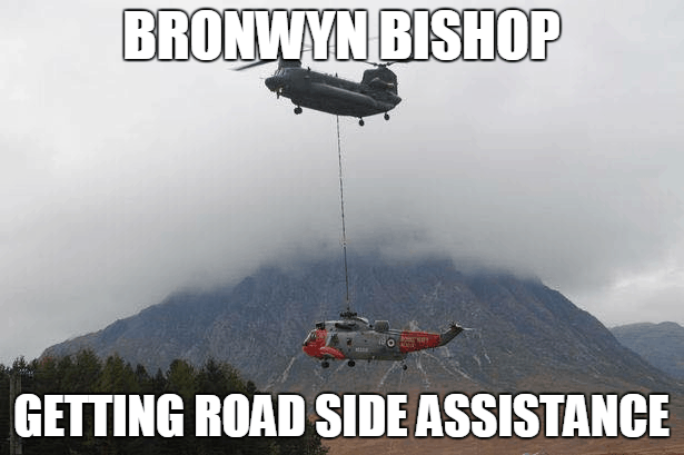 A photograph of a helicopter suspended beneath a larger helicopter with the text:'Bronwyn Bishop Getting Road Side Assistance'
