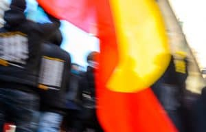 close up of Australian Aboriginal flag being carried by protestors