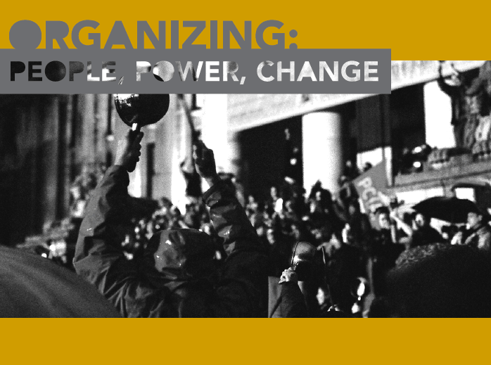Cover of the handbook. Includes a black and white photograph of a group of people rallying and the text 'Organizing: People, Power, Change'