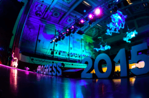 A stage with colours flights and the words Progress 2015 spelled out in oversized white letters