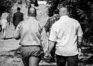 Two men holding hands.