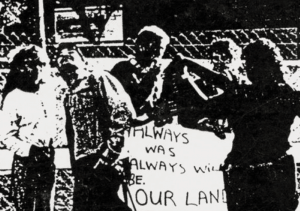 black and white image of Aboriginal activists with a sign saying Always as Always will be our land