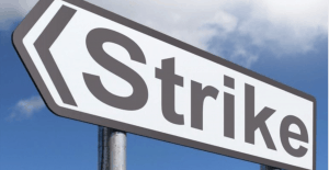 sign with arrows says strike