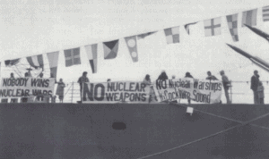 anti nuclear protestors on USS Worden ship with protest banners saying No Nuclear Weapons