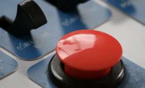 close up of red button on panel of buttons