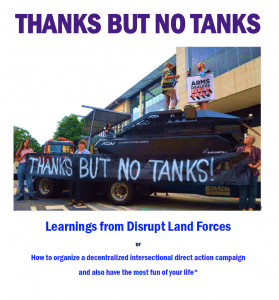 protestors with a banner that says Thanks but no tanks