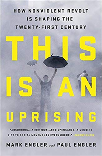 Cover of 'This is an Uprising'. Includes photograph of a person holding an umbrella surrounded by tear gas.