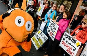 Person dressed in Nemo fish costume at a protest