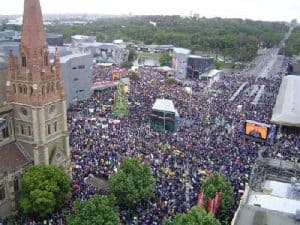 Aerial photograph of huge crowd filling Federation Square and surrounding streets.