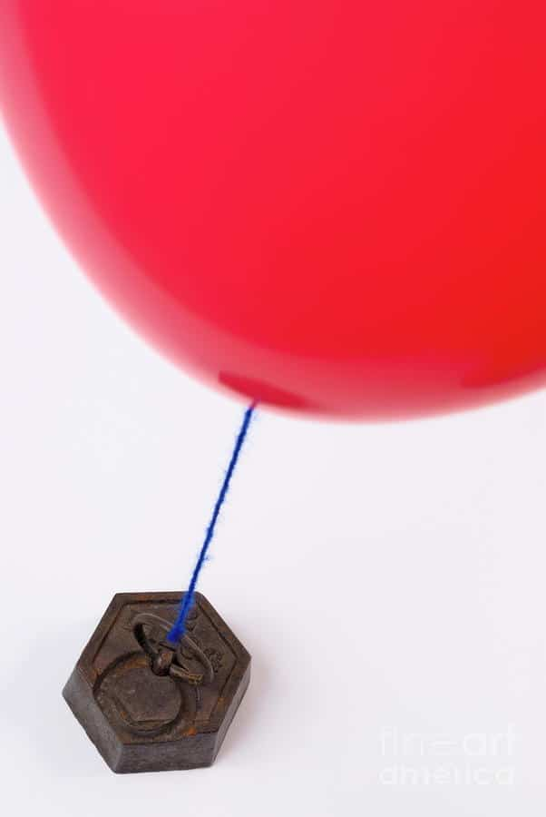 red balloon tied to metal weight