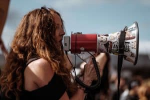 Female protestor speaking into a megaphone