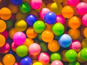 Photograph of multiple coloured plastic balls.