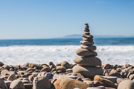 A stack of balancing rocks on a seashore