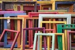 lots of colourful empty picture frames leaning on each other