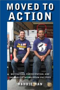 Cover of the booklet 'Moved to Action', includes a photograph of two smiling people wearing union tshirts.