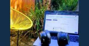 laptop and headphones outside in garden